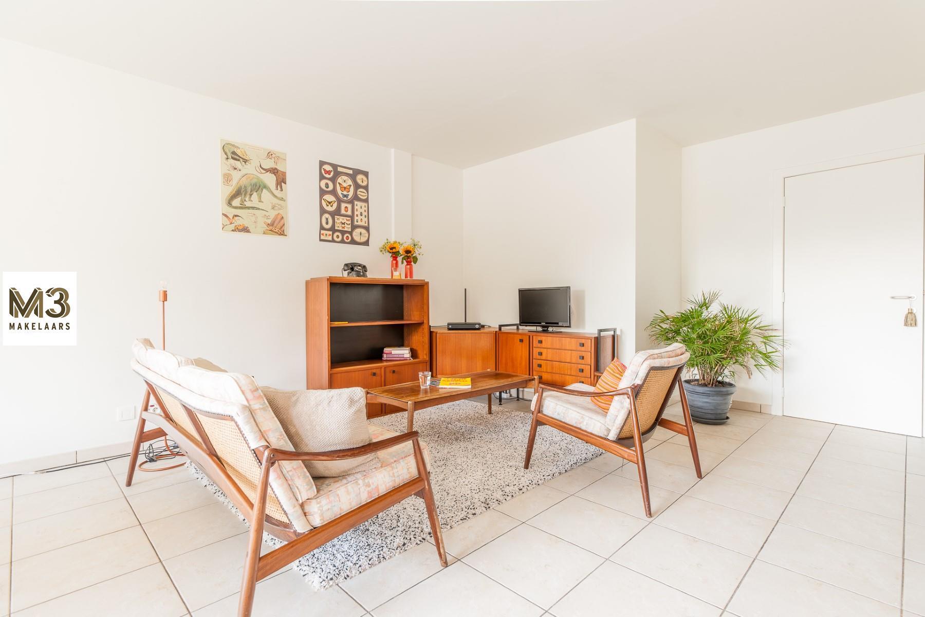 Gezellig en rustig appartement met groot terras en garage!
